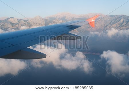Beautiful view from the airplane window. Mountains of the clouds and the sea. Flight from Ukraine to Turkey