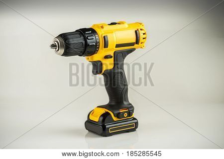 modern battery drill screwdriver on a gray background