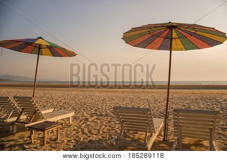 Chairs With Sun Umbrella On A Beach