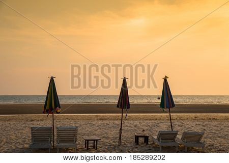 Chairs With Sun Umbrella On A Beach