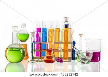 Laboratory glass filled with colorful substances. Chemical liquid measurement and analysis on white background.
