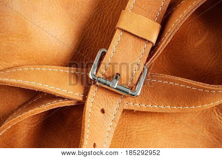 Sash and metal accessories for leather luggage.