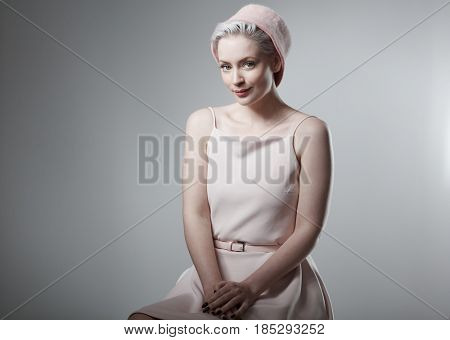 Smiling woman in retro style .
