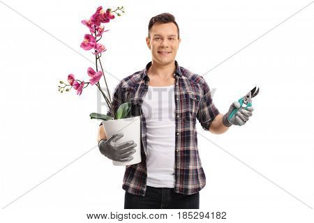 Gardener with an orchid plant in a pot and garden shears isolated on white background