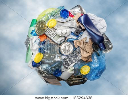Sphere as Planet Earth formed from assorted domestic waste over blue sky