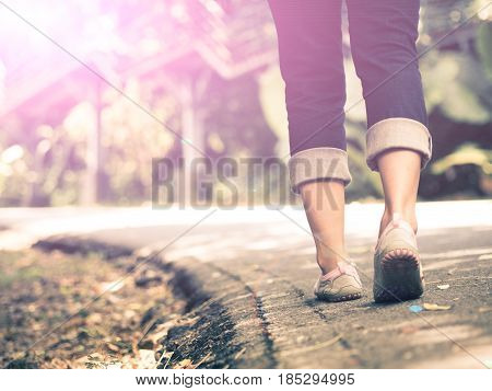 woman walking towards on the road side.