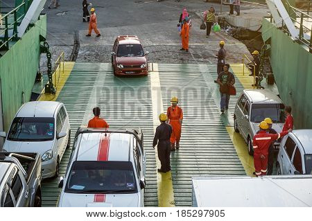Labuan,Malaysia-May 7 2016:Vehicles & passengers on the ferry at Labuan terminal,Malaysia.The government to allocate the subsidy for travellers' sea transport cost from Labuan to the mainland of Sabah