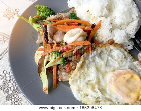 Sauteed Mixed Vegetables N Oyster Sauce With Rice And Fried Egg On White Plate. Thai Food.