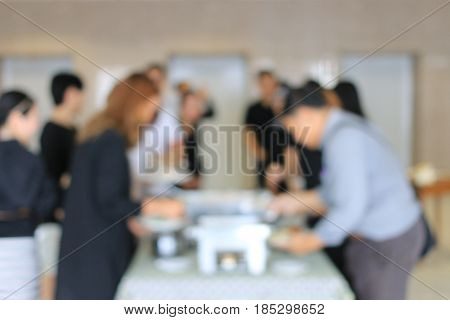 Abstract Blur Image Of Lunch Break Business People In Line Wait For Food Meals. Indoor Catering Food