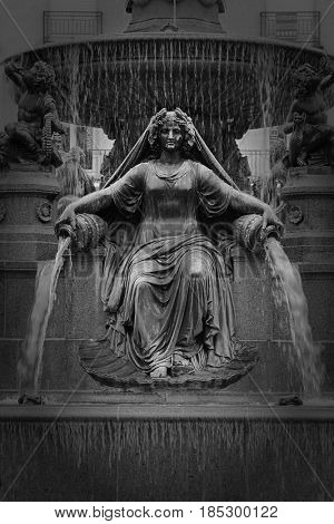 Fountain of La Loire a women sit at place Royale in Nantes, France
