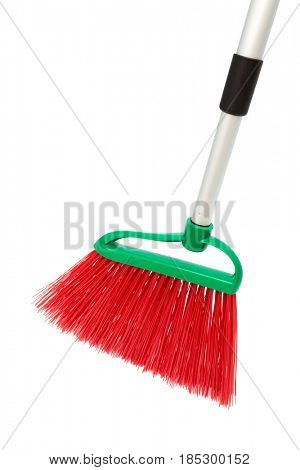 red and modern broom on white background