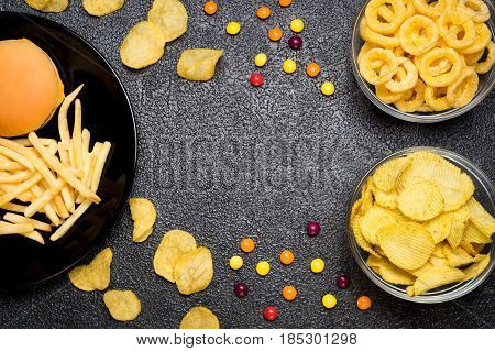 Fast Food: Top View Of Burger, French Fries, Chips, Rings And Candies. Unhealthy Eating Concept