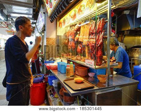 People At The Market In Chinatown, Singapore