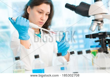 Young woman in microbiological laboratory.
