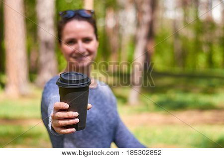 Beautiful Young Girl Gives A Cup Of Morning Coffee