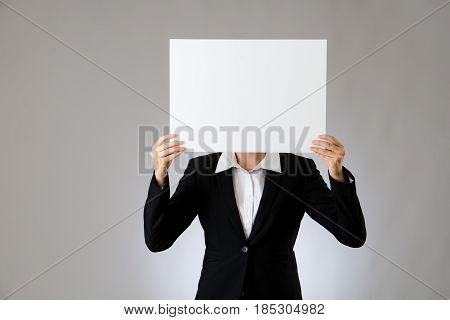 Young Woman Holding White Card Over Face