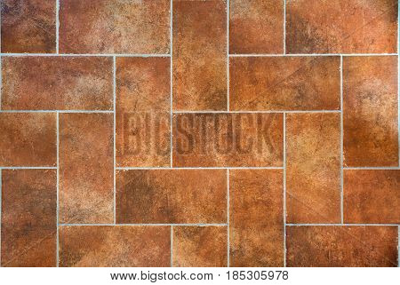 Tuscan traditional old and grunge floor red ceramic stoneware tiles. Italian rural interior.
