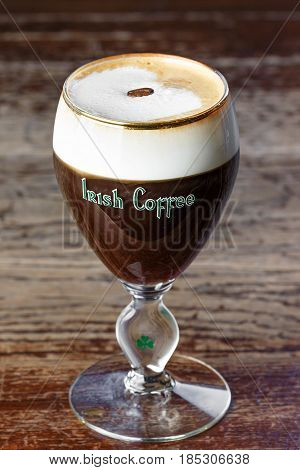 Irish coffee space for text. Photo for the menu. Irish coffee with whiskey black coffee and cream