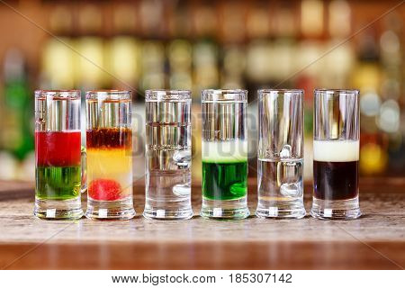 Multi-layer cocktails for a party colorful cocktails for entertainment in a nightclub