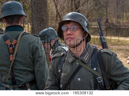 Gatchina Russia - May 7 2017: Historical reconstruction of the battles of World War II. A participant in the reconstruction in the form of a Wehrmacht soldier before the start of the battle.