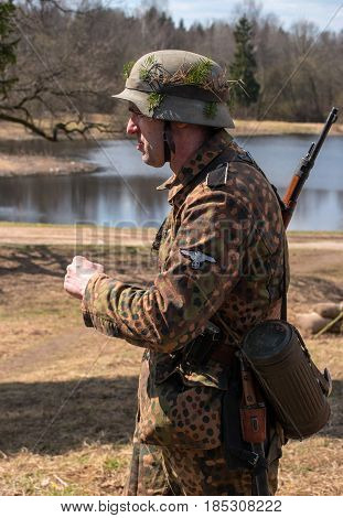 Gatchina, Russia - May 7, 2017: Historical reconstruction of the battles of World War II. A participant in the reconstruction in the form of a Wehrmacht soldier before the start of the battle.
