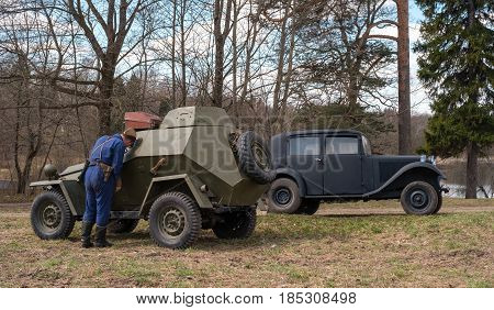Gatchina, Russia - May 7, 2017: Historical reconstruction of the battles of World War II. Soviet armored car and passenger car Mercedes Benz.