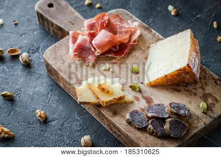 Cheese And Meat Platter. Spanish Ham Jamon Serrano Or Italian Prosciutto Crudo, Sliced Italian Hard