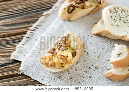 Baguette Slices With Homemade Cheese Dip Made Of French Soft Cheese From Brittany Region Or Brie, Ca