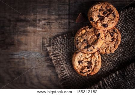 Homemade Chocolate chip cookies freshly baked on rustic wooden table. Selective Focus. Copy space.