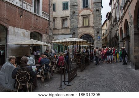 Italy Lucca - September 18 2016: the view of open air cafe on lucca's street on September 18 2016 in Lucca Tuscany Italy.