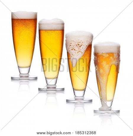 set of glass of light beer foam. lager beer in a glass beaker with fresh bubbling foam isolate on white