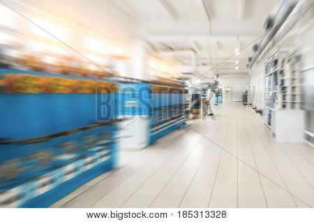 Modern production hall. Abstract industrial background, blur effect in motion.