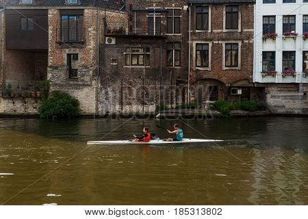 Tourist Kayaking In Ghent Canal