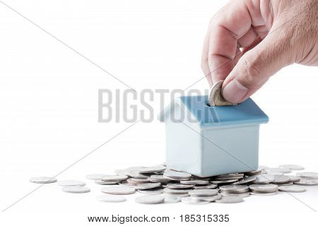 Business Man Hand Put Coin To House Piggy Bank
