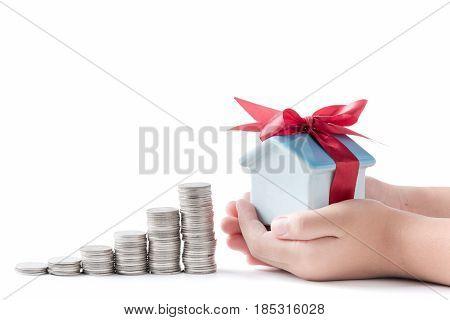 House Piggy Bank In Little Hand