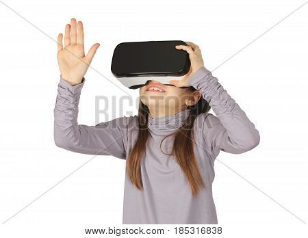 child girl using virtual reality goggle on white