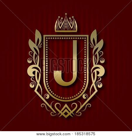 Golden royal coat of arms in medieval style. Vintage logo with J monogram.