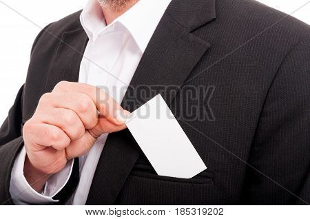 Closeup Of Entrepreneur Putting Business Card In Pocket