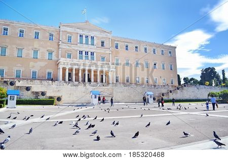 ATHENS GREECE, JANUARY 12 2016: the greek parliament with the greek Evzones soldiers, guarding the tomb of the unknown soldier at Syntagma Athens Greece. Editorial use.