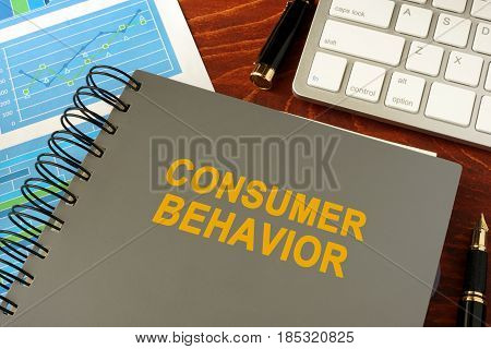 Book with title consumer behavior in an office.