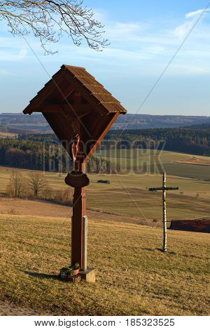Thalmaessing, Germany - Feb 26 2017 : Wayside Cross With Carvings And Simple Birch Cross
