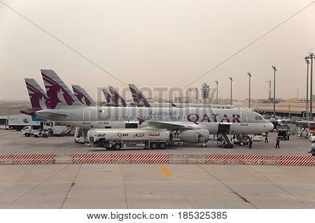 DOHA, QATAR - APRIL 4: Aircrafts of the Qatar airways fleet at Doha International Airport April 4th, 2014. Qatar Airways is rated as a 5-star airline.