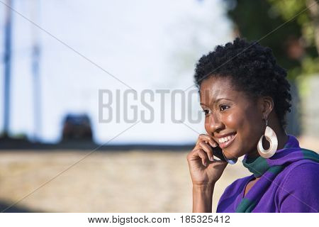 African American woman talking on cell phone outdoors