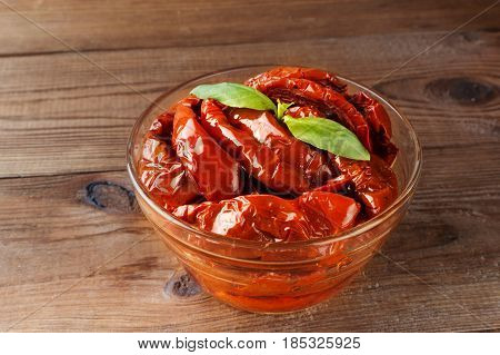 Italian Appetizer - Sundried Tomato In Bowl On The Wooden Table
