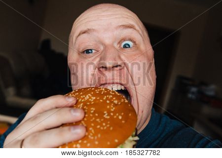 The Eating Of A Hamburger By A Man With A Terrible Expression