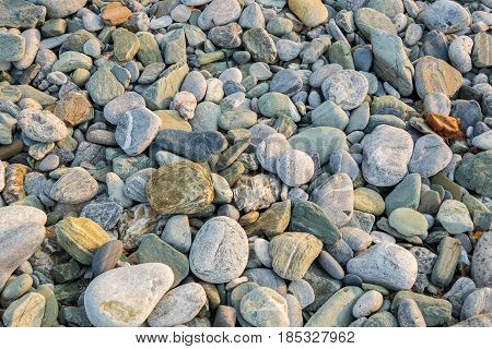 Colourful pebble on a stone beach. Greece