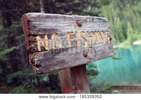 No fishing prohibited warning sign by lake