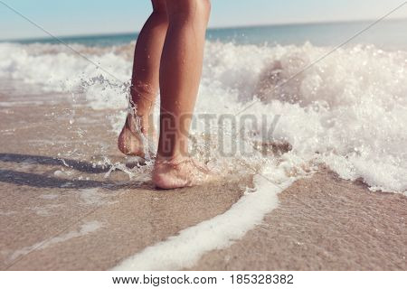 Jumping in the sea waves concept for summer beach vacation