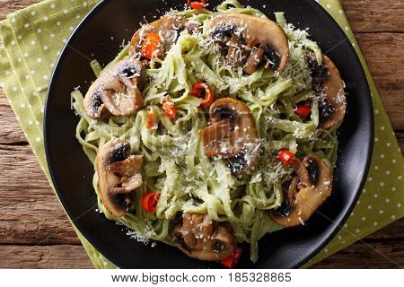 Spinach Noodles With Mushrooms And Parmesan Cheese Close-up. Horizontal Top View