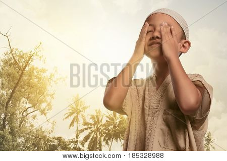 Religious Asian Muslim Boy Praying To God